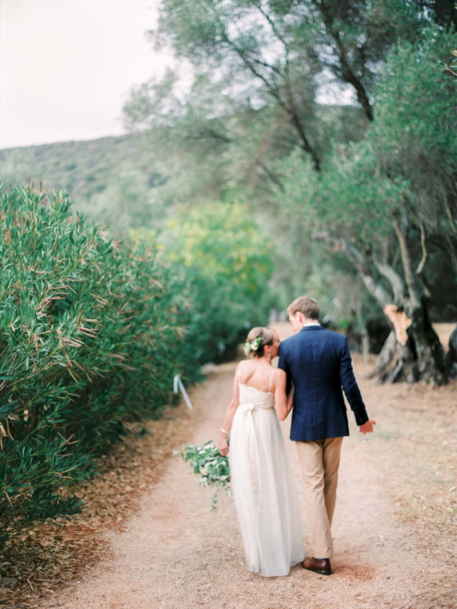 Bride and groom romantic walk to dinner at Gentilini Retreat, Cephalonia