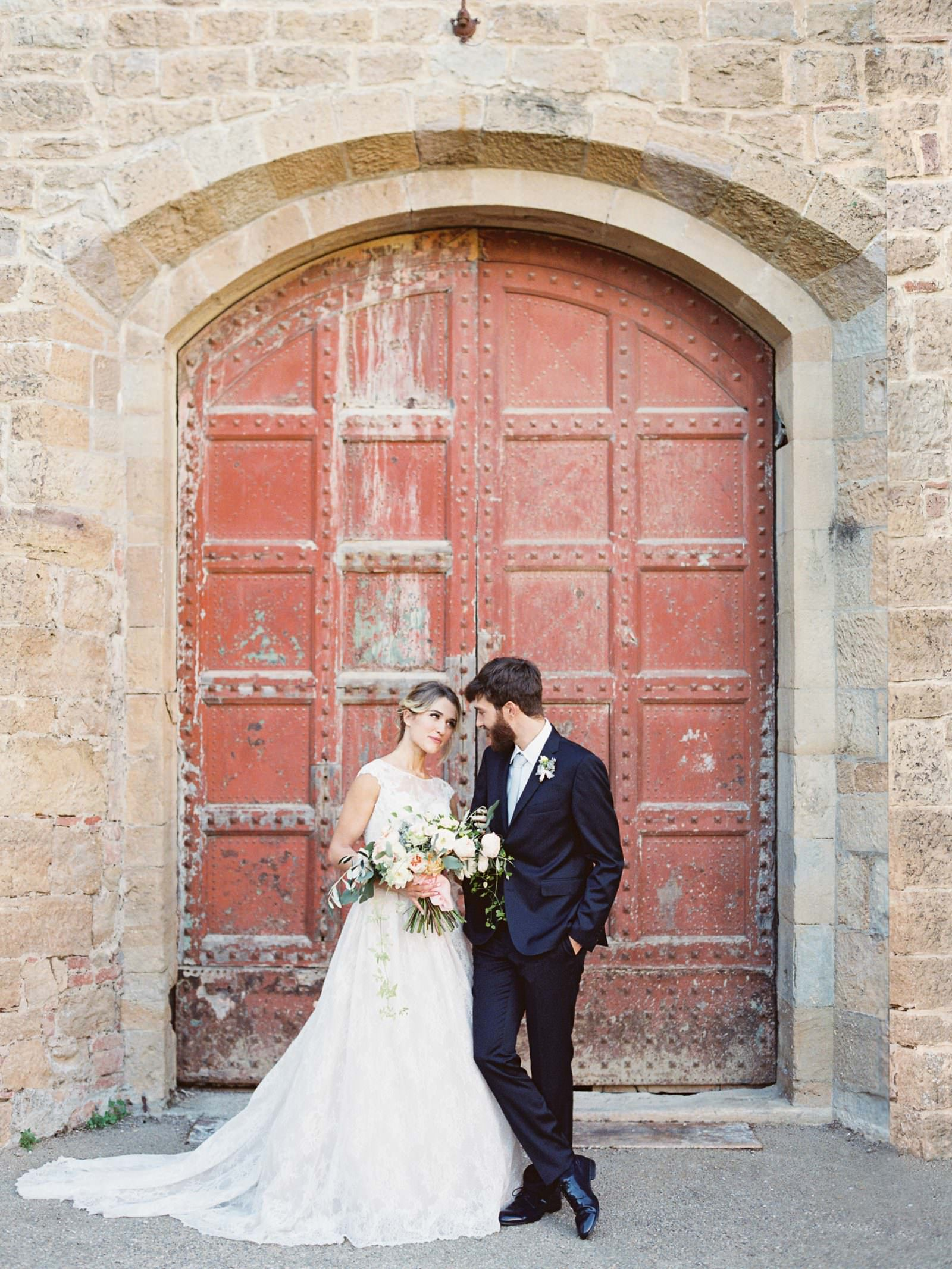 Castelfalfi, Toscana, Italy bridal portrait at the famous castle main doors