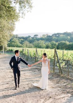Real couple married loving the scenary at a vineyard in Tuscany