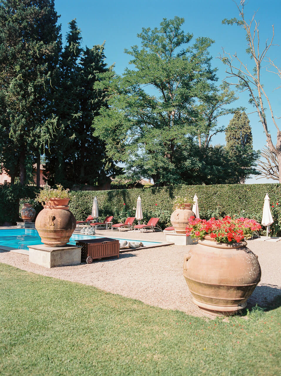 swimming pool and lounge area at Luxury Wedding Venues in Florence Villa Mangiacane