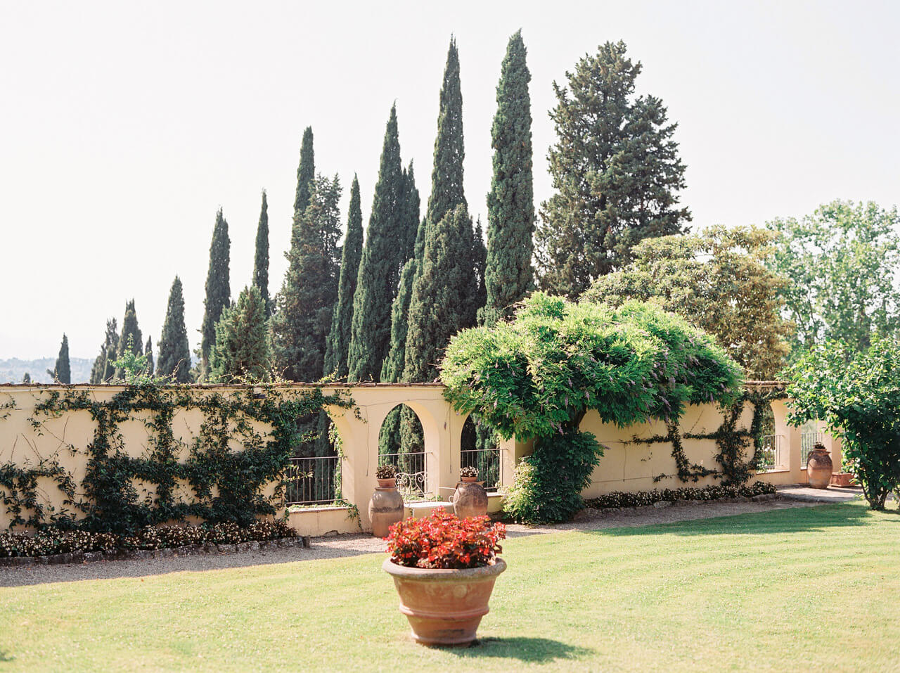 Tuscany country villa wedding setting and Cyprus trees at Villa Agape Art Hotel