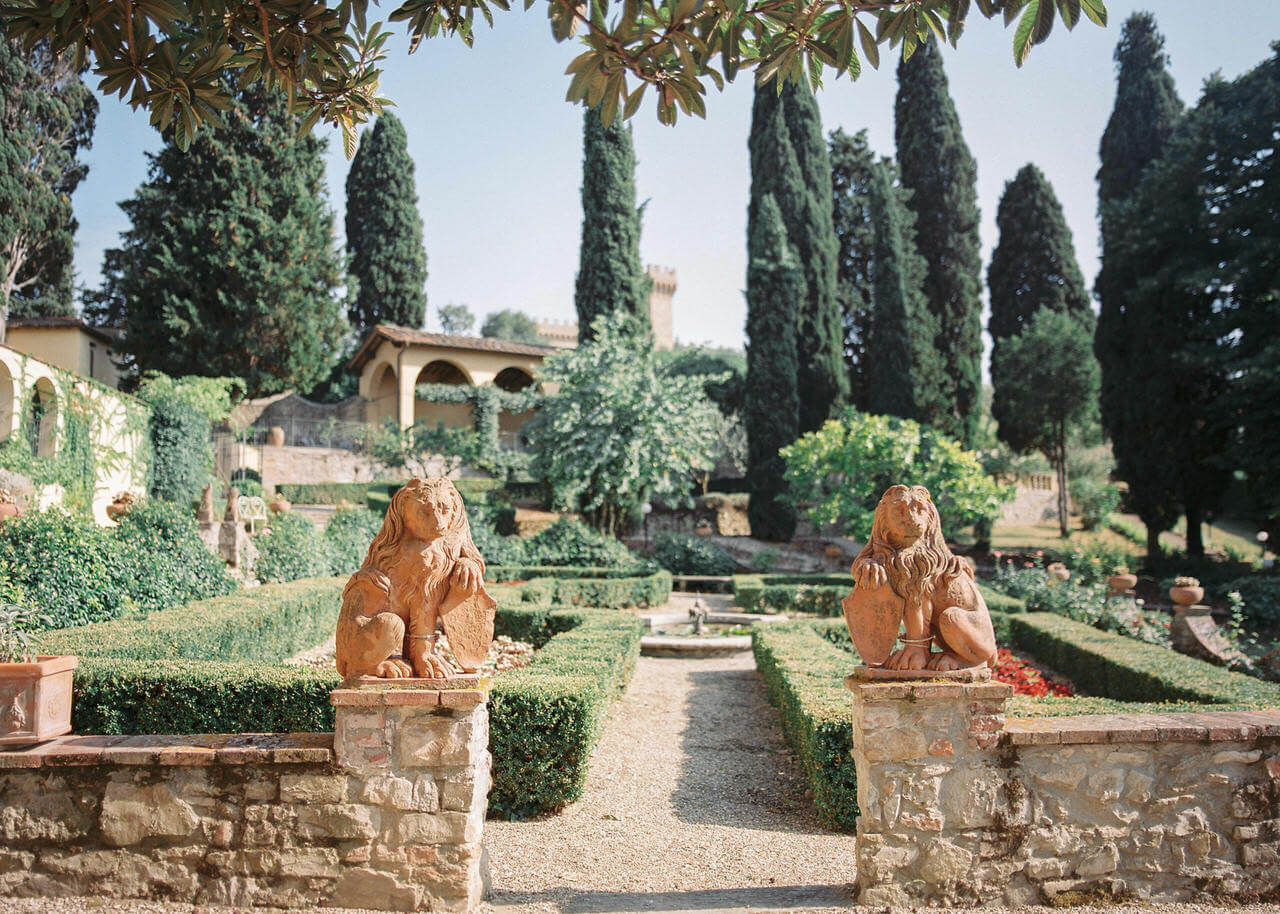 A wedding Venue with lion statues and manicured Italian gardens