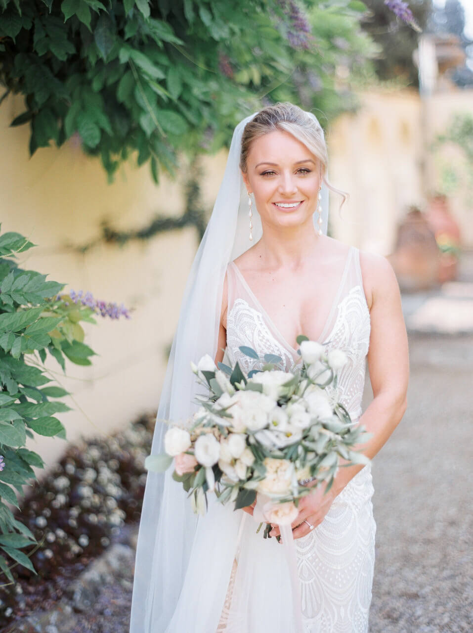 A smiling bride just before her first look in italy at Villa Agape Art Hotel Florence